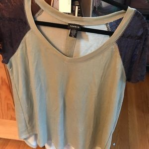 Light olive green top with dark gray lace sleeves